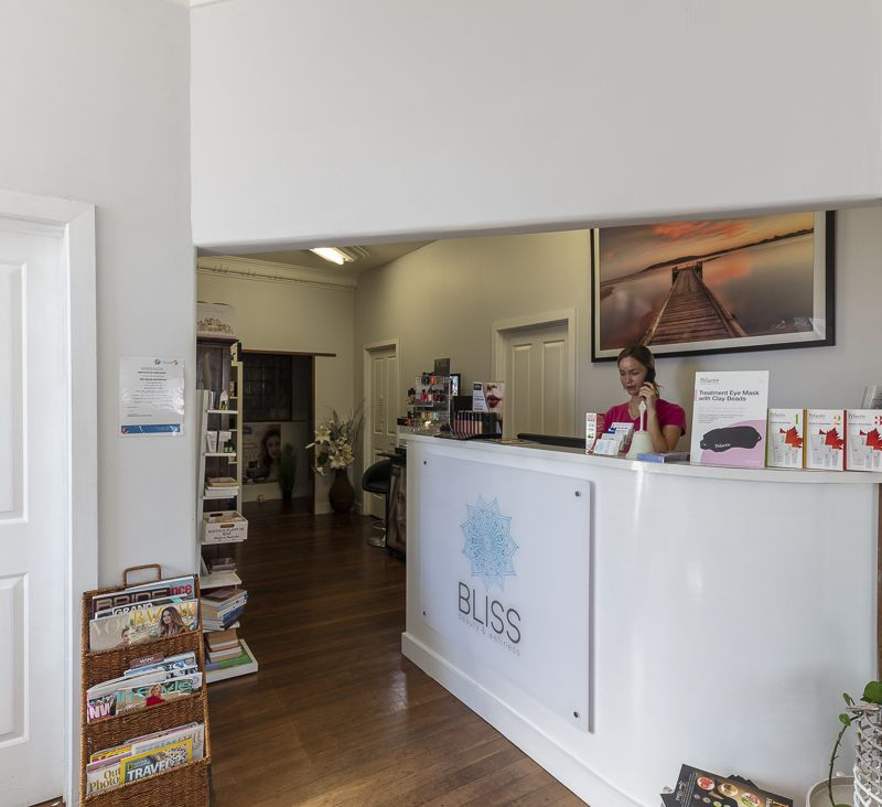 Receptionist Kate behind our front desk. Looking through to the retail area of the salon